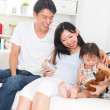 Asian pregnant couple enjoying quality time with family — Stock Photo