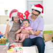 Asian chinese young family celebrating christmas — Stock Photo #33097581