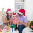 Asian chinese young family celebrating christmas — Stock Photo #33097585