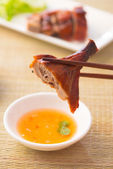 Chinese asian roast duck with chopstick and sauce — Stock Photo