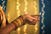 Diwali festival of lights , hands holding indian oil lamp — Stock Photo
