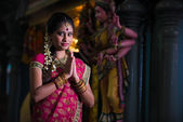 Traditional indian female praying in the temple — Stock Photo