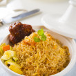 Chicken biryani served with crockery — Stock Photo