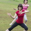 Asian girls working out outdoor park — Stock Photo