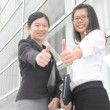 Asian business women with thumbs up — Stock Video