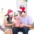 Asian chinese young family celebrating christmas with baby cryin — Stock Photo