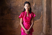 Myanmar girl in a traditional clothes standing — Stock Photo