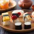 Sushi Assortment On wooden Dish, close up — Stock Photo