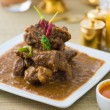 Mutton kormfamous food with traditional indibackground item — Stock Photo #34254477