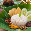 Nasi lemak, traditional malay curry paste rice dish served on — Stock Photo #34254795