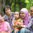 Malay family having fun in the park ,malaysian people — Stock Photo #34255035