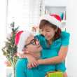 Asian couple life christmas celebration gift sharing — Stock Photo #34255133