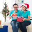 Asian couple life christmas celebration gift sharing — Stock Photo #34255195