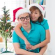 Asian couple life christmas celebration gift sharing — Stock Photo #34255213