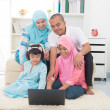 Stock Photo: Malay indonesian family surfing internet at home.