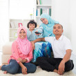 Malay family watching television enjoying quality time — 图库照片