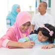 Malay indonesiMuslim family colouring at home. — Stock Photo #34255367