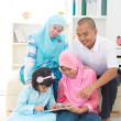 Malay indonesian family surfing internet at home. — Stock Photo