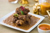 Mutton korma famous food with traditional indian background item — Stock Photo