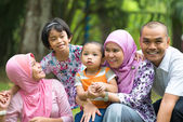 Malay family having fun in the park ,malaysian people — Stock Photo