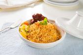Biryani chicken rice cooked in arab style tajine with traditiona — Stock Photo