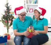 Asian couple life christmas celebration gift sharing — Stock Photo
