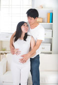 Asian pregnant mother and her husband — Stock Photo