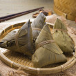 Stock Photo: Rice dumplings and chinese teon bamboo place mat