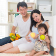 Asian pregnant mother with her family at the living room — Stock Photo