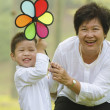 Happy asian grandmother with grandson child playing outdoor — Stock Photo
