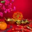 Chinese New Year Decoration plum blossom and gold bullion symbol — Stock Photo #35651001