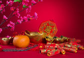 Chinese New Year Decoration plum blossom and gold bullion symbol — Stock Photo