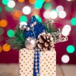 Christmas decorations and presents with background lights — Stock Photo