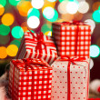 Christmas present and gifts with lights at the background — Stock Photo