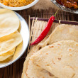 Постер, плакат: Chapati or Flat bread Indian food made from wheat flour dough
