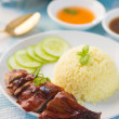 Roasted duck, Chinese style, served with steamed rice on dining — Stock Photo #35839101
