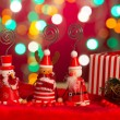 Stock Photo: Christmas elves, santand snowmtoy with lights background