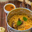 Chicken biryani in small wok — Stock Photo