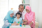 Indonesian muslim family learning together — Stock Photo