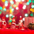 Christmas elves, santa and snowman toy with lights background — Stock Photo