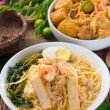 Singapore famous curry noodle or laksmee with decorations on b — Stock Photo #37559907