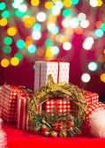 Christmas decorations and presents with background lights — Photo
