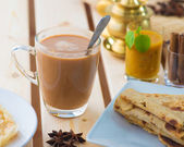 Roti canai and teh tarik, very famous drink and food in malaysia — Stock Photo