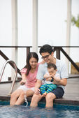 Happy chinese Asian Family Playing in the pool — Stock Photo