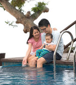 Happy Asian Family Playing in the pool — Stock Photo