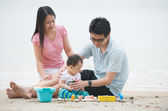 Happy Asian Family Playing on the beach — Stock Photo