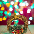 Christmas decorations and presents with background lights — Stock Photo #38375005