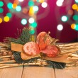 Christmas decorations and presents with background lights — Stock Photo #38375021