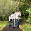 Happy indian family walking outdoor in the park — Stock Photo #38375095