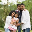 Happy outdoor indian family in the park — Stock Photo #38375107